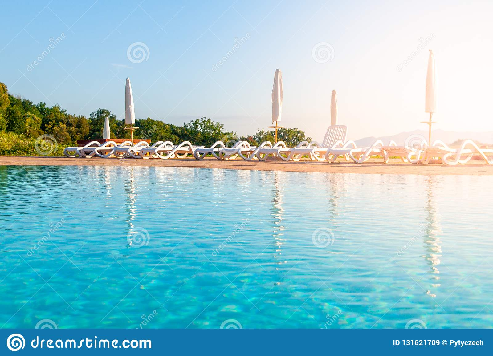 Beautiful luxury swimming pool with bright blue water - How to make swimming pool water blue ...