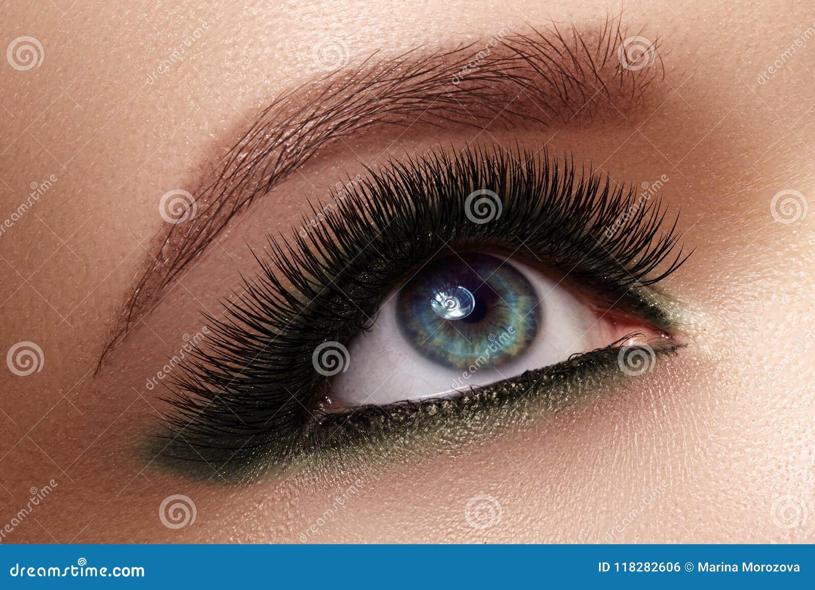 4b33a5a8473 Beautiful macro shot of female eye with extreme long eyelashes and black  liner makeup. Perfect shape make-up and long lashes. Cosmetics and make-up.  Closeup ...