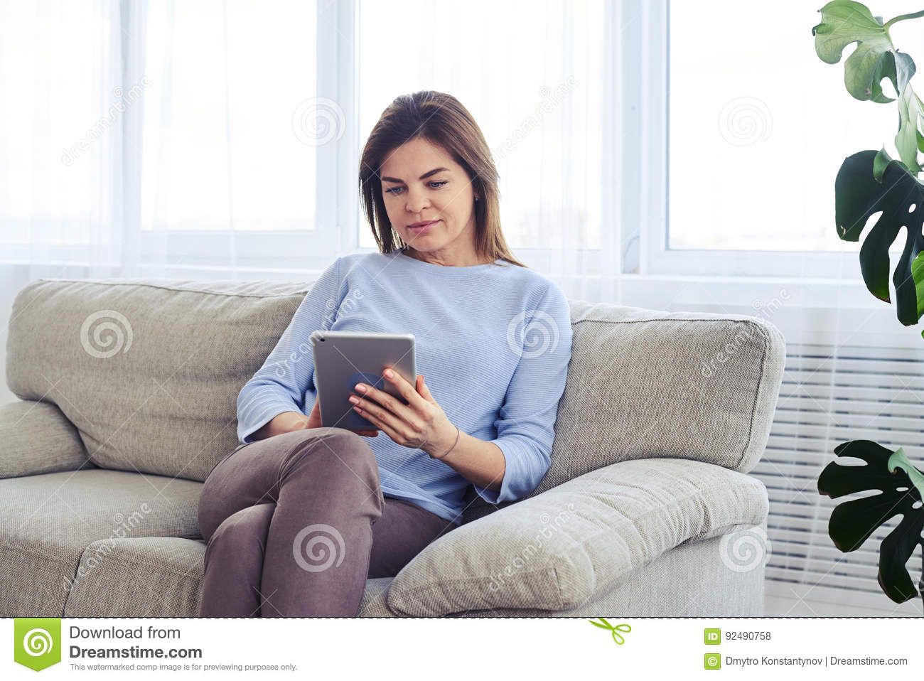 Beautiful madam of age 35-45 concentrating on work in laptop