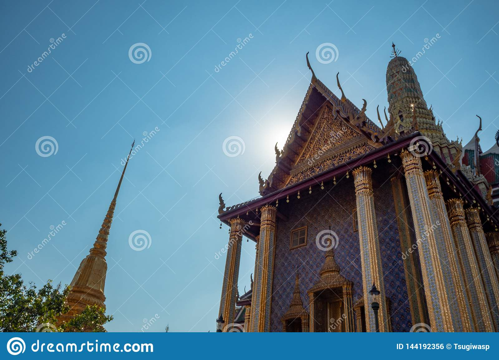 Main hall of royal temple in the grand palace of thailand on blue sky background