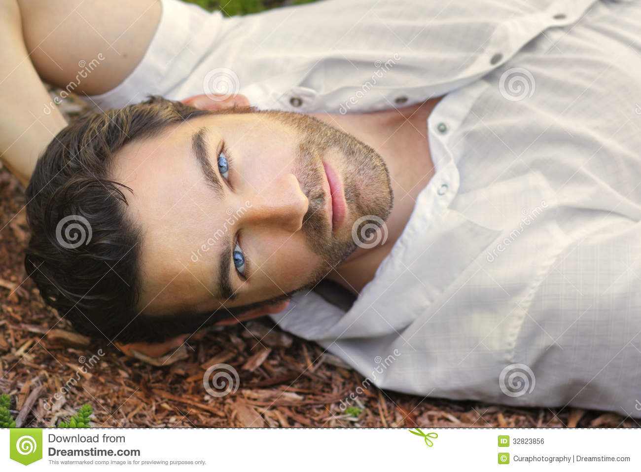 Portrait of young man outdoors with very handsome face in white casual ...