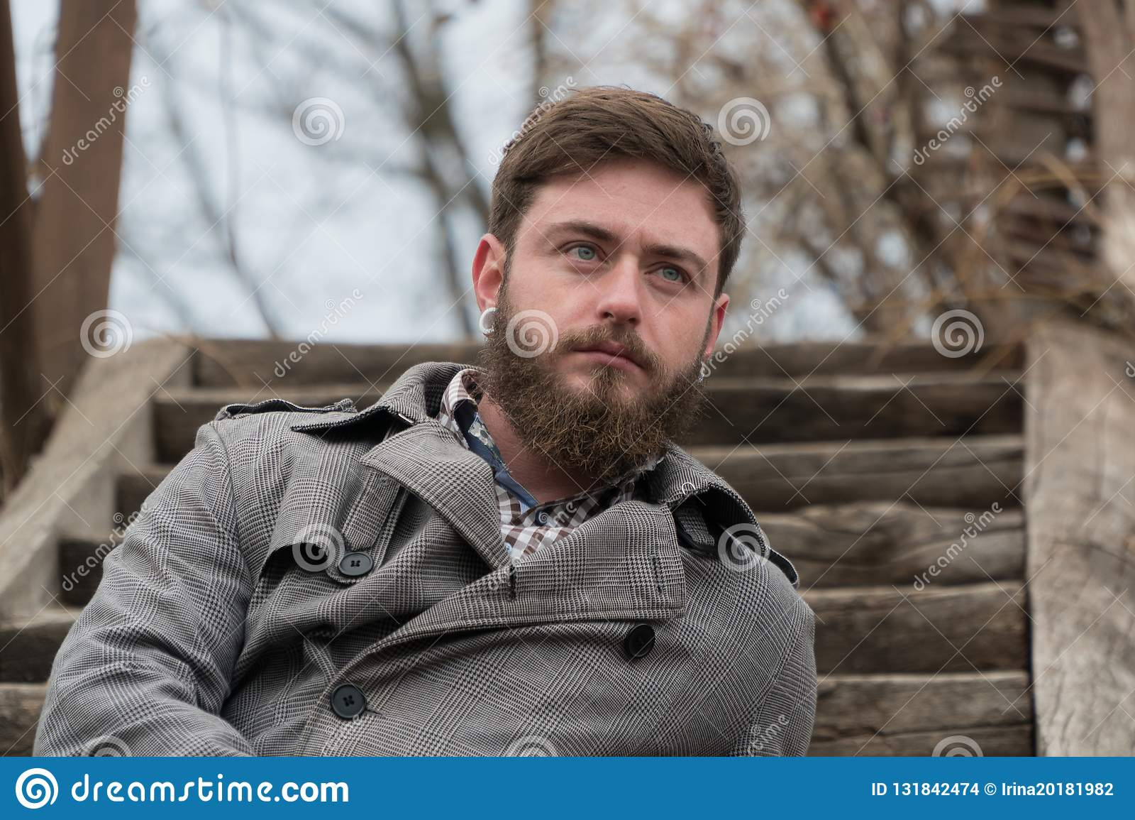 Beautiful man. man with beard. sit autumn Park