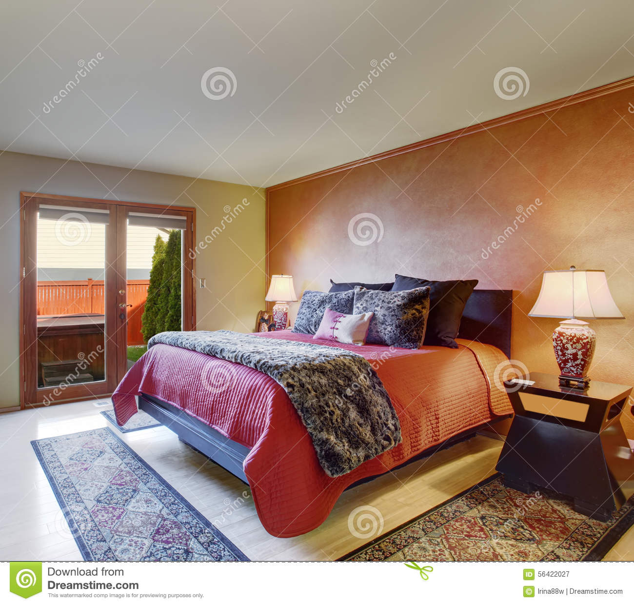 Beautiful Master Bedroom With Red Bedding And Beige Walls ...