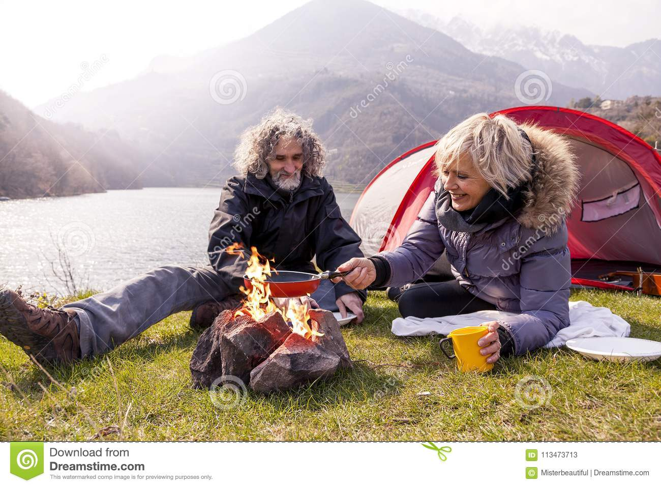 Beautiful mature couple relaxing and cooking eggs
