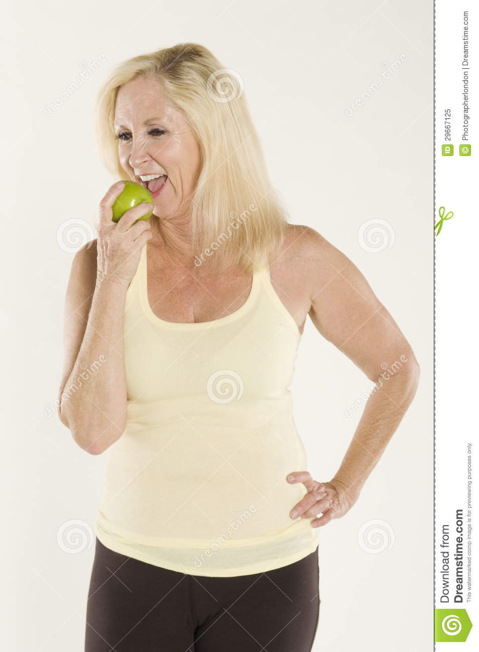 Beautiful Mature Woman Eating A Fresh Green Apple Stock -8622