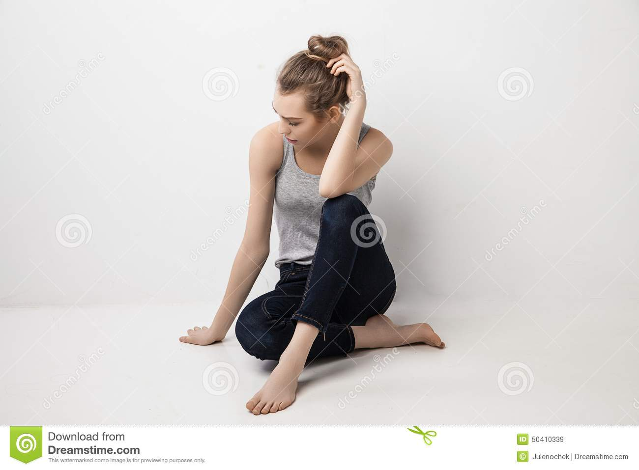 beautiful melancholic girl sitting on the floor stock image image of face attractive 50410339. Black Bedroom Furniture Sets. Home Design Ideas