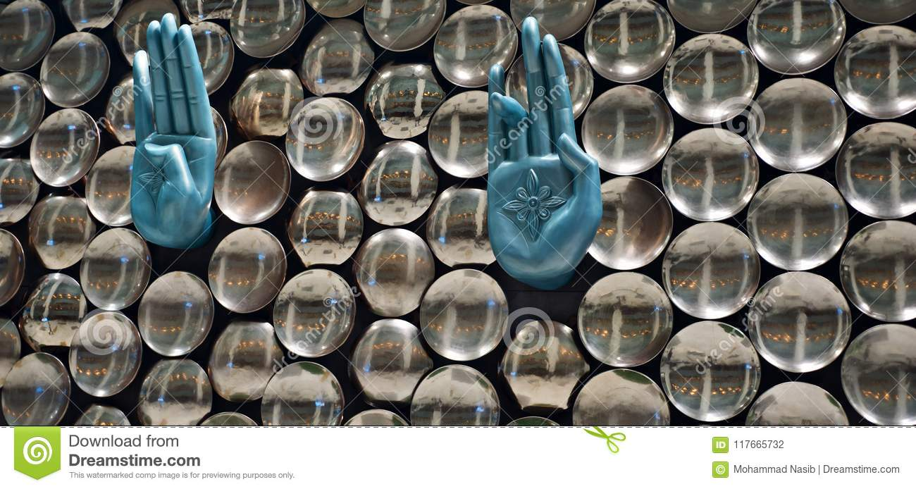 Download Stylish Metallic Hand Sign Of An Interior Decoration Wall Unique Photo Stock Photo - Image of wall, hand: 117665732