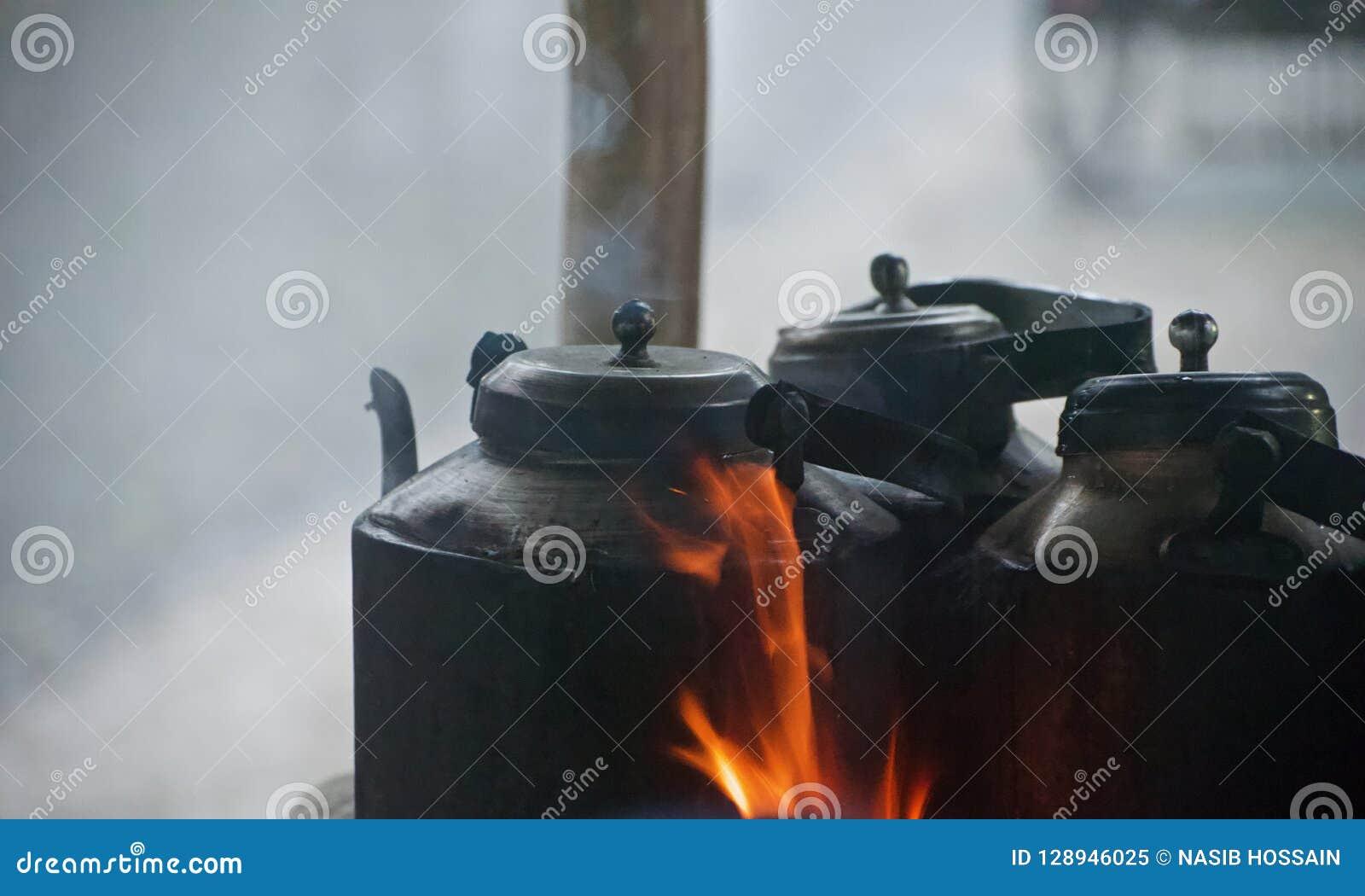 Metallic tea kettles around a tea shop unique photo