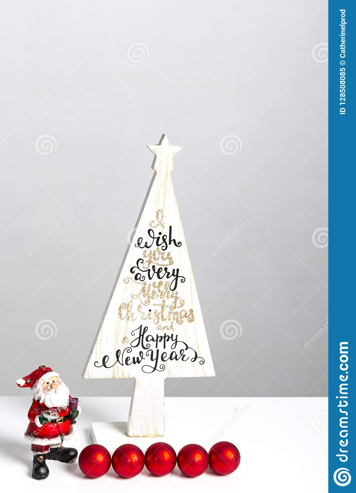 Beautiful Minimal Christmas Wood Tree With Merry Christmass And Happy New Year Written With Small Santa Claus And Red Balls On W Stock Image Image Of Celebration Nature 128508085