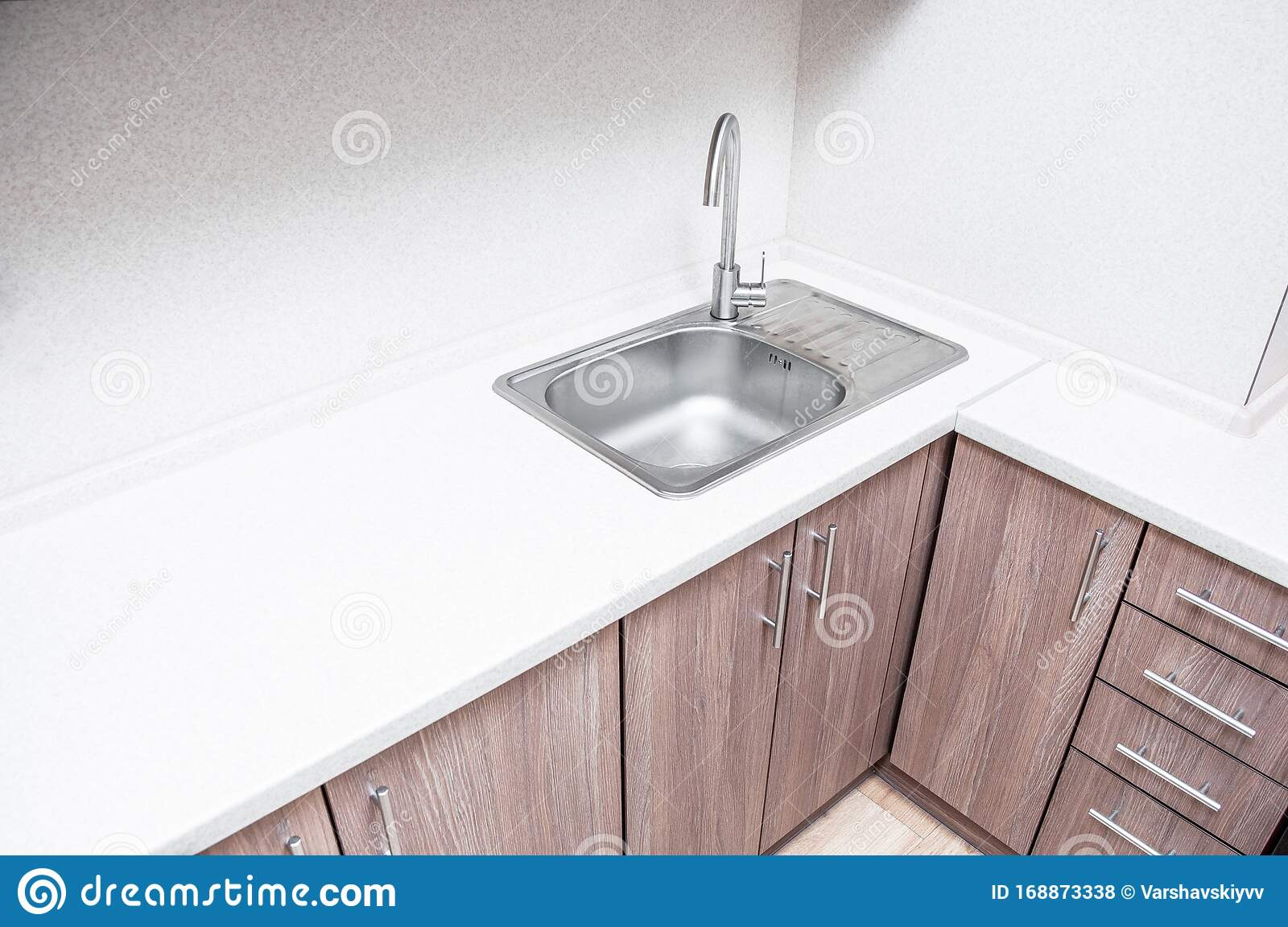 A Beautiful And Minimalistic Workplace For A Housewife Aluminum Sink With Tap Fitting In The Corner Of The Kitchen Worktop Stock Photo Image Of Mtterrier Order 168873338