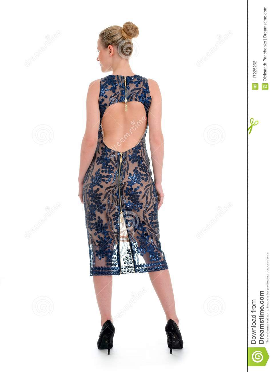 beautiful model with blond hair show printed blue dress for catalog standing back isolated on white