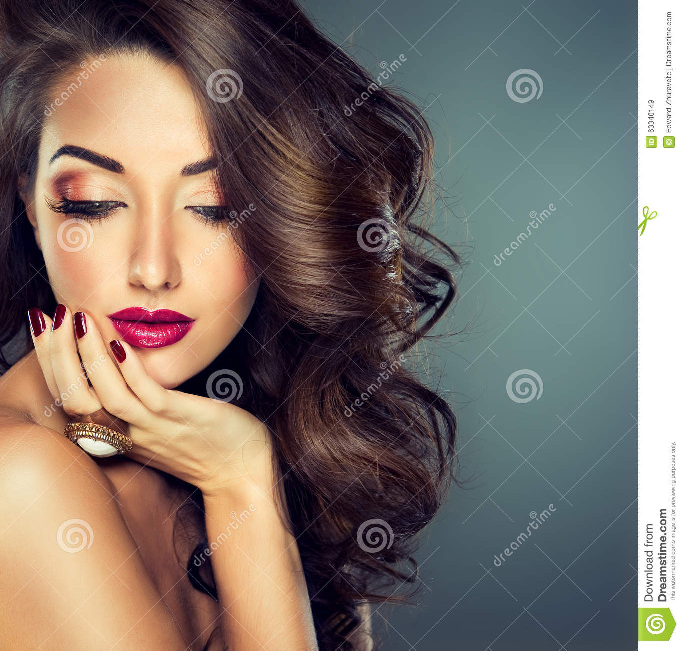 Beautiful model brunette with long curled hair stock image image 63340149 Fashion style and make up