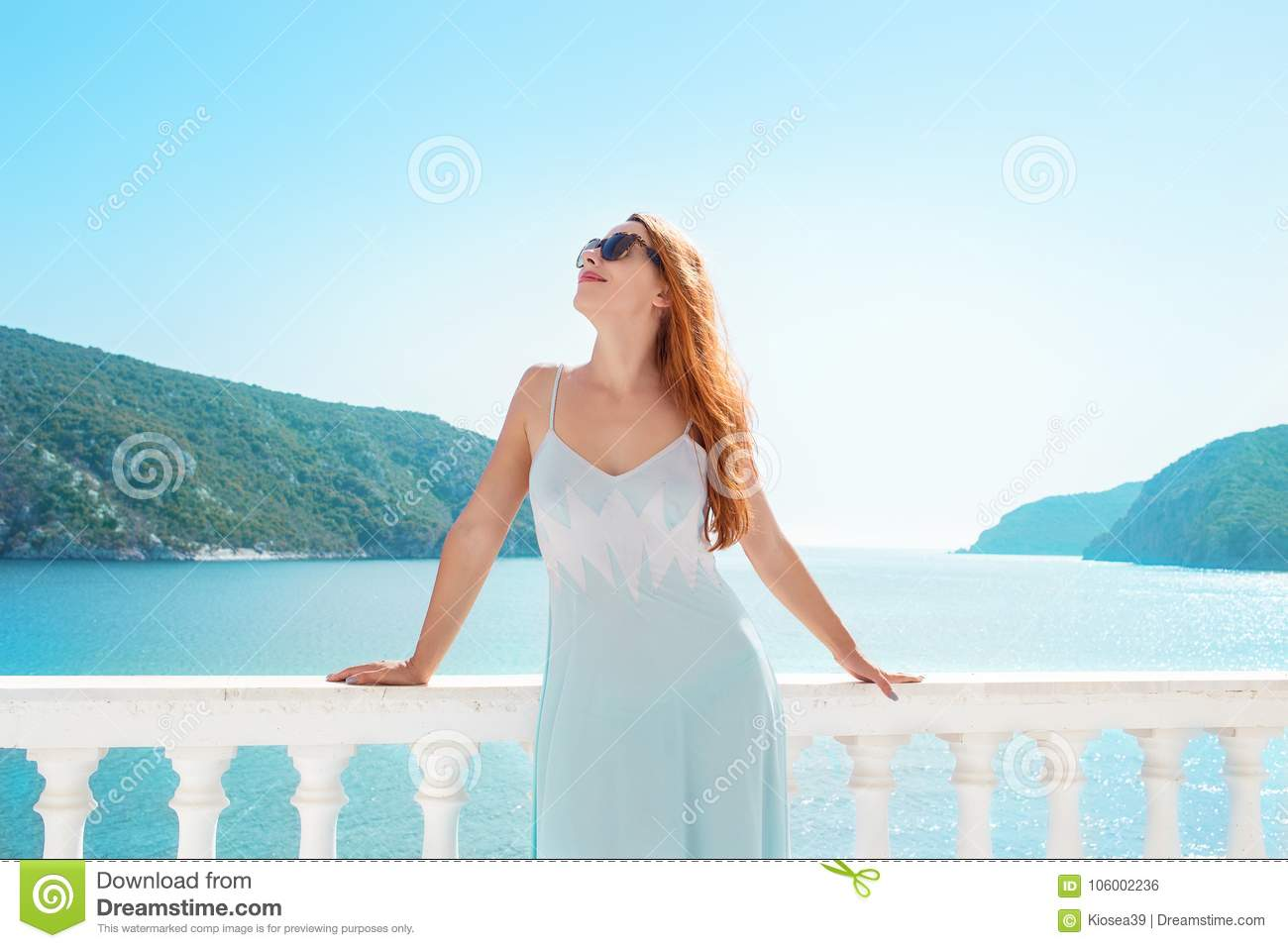 Content woman chilling on tropical terrace
