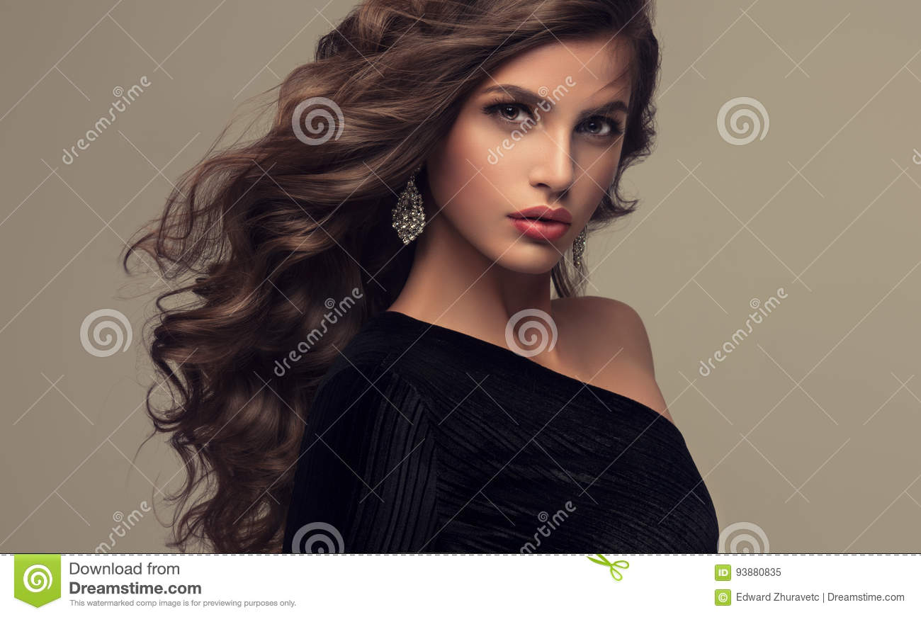 Voluminous hairstyles for long hair - Beautiful Brunette Dense Frizzy Hairstyle Long Model Shiny Voluminous