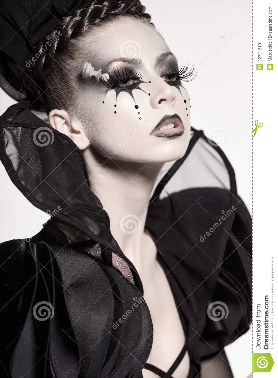 beautiful model posing as chess queen - fantasy make-up stock photo