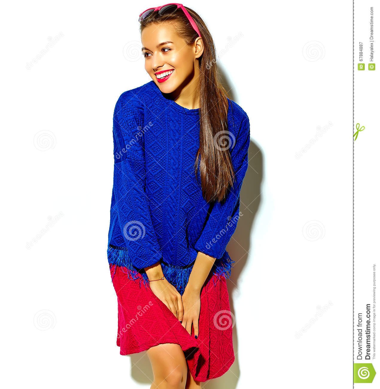 Beautiful model in summer stylish clothes in studio