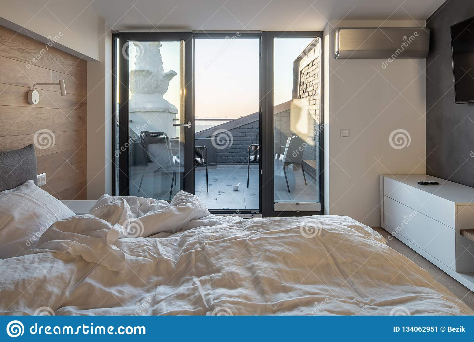 Sunny Bedroom In Modern Style With Light Walls Stock Image