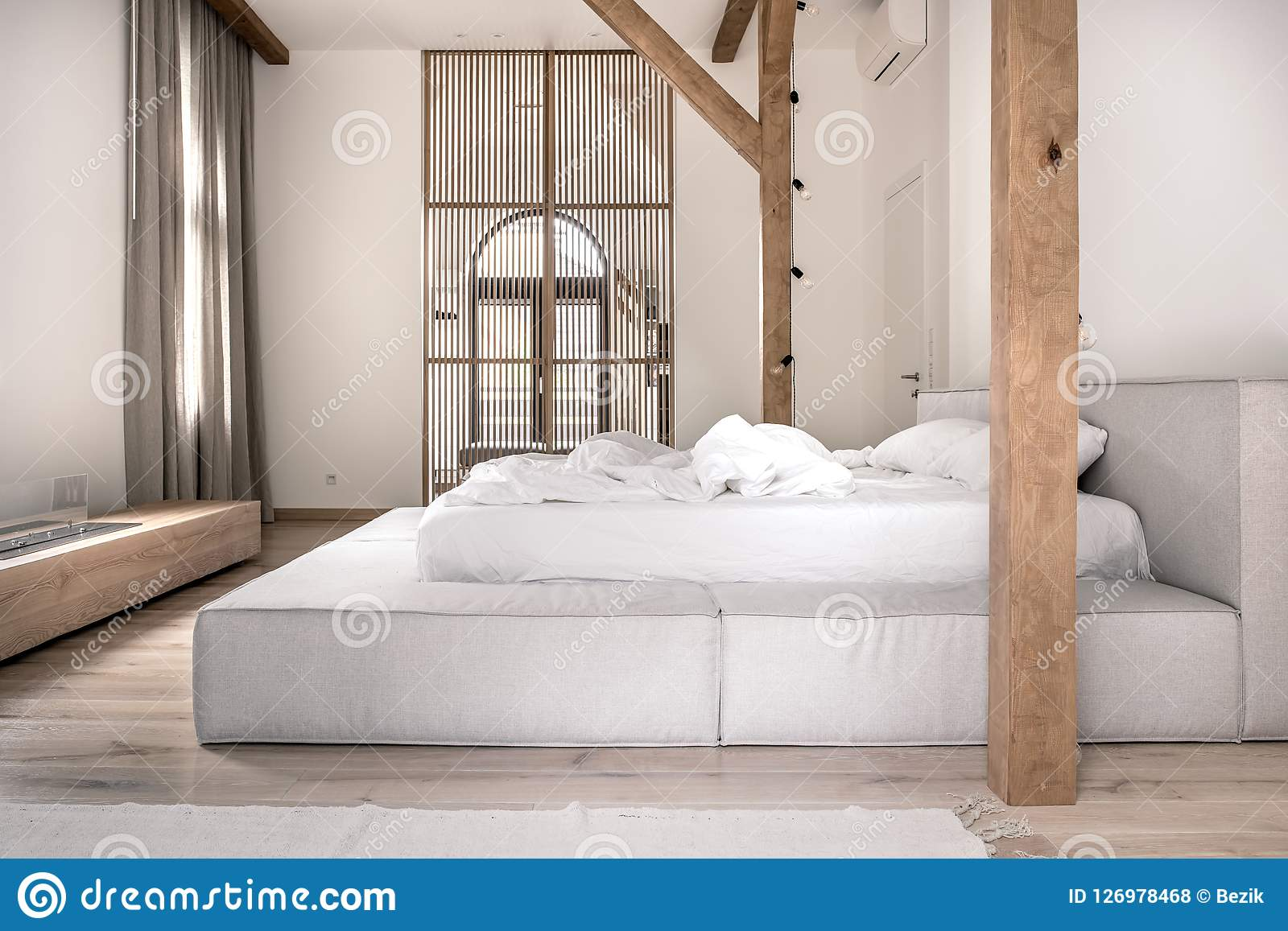 Stylish Bedroom In Modern Style With Wooden Beams Stock Photo Image Of Mansion Door 126978468
