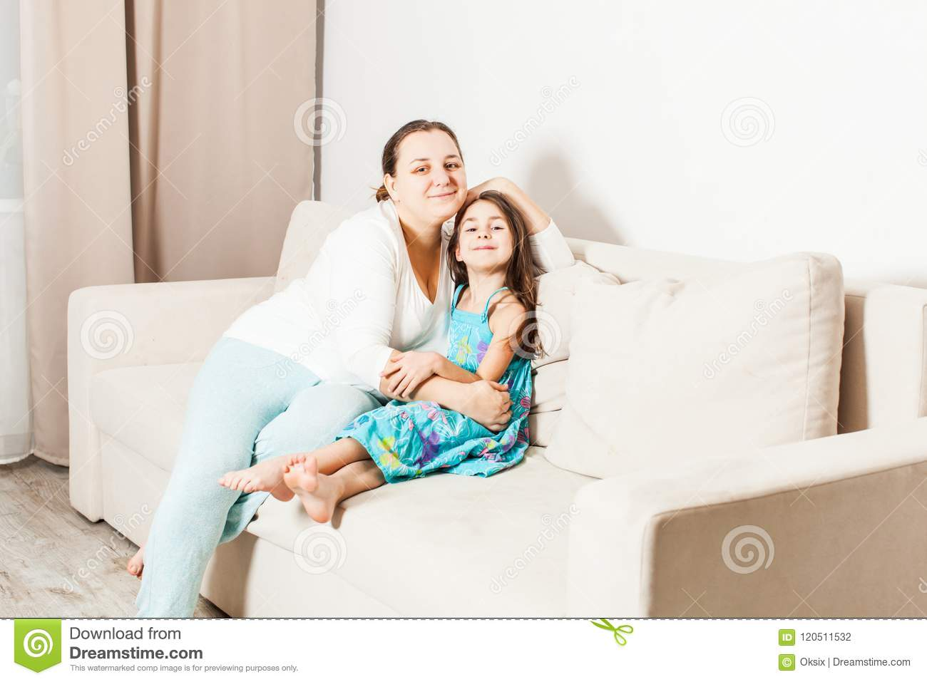 Beautiful mom and daughter in the living room.