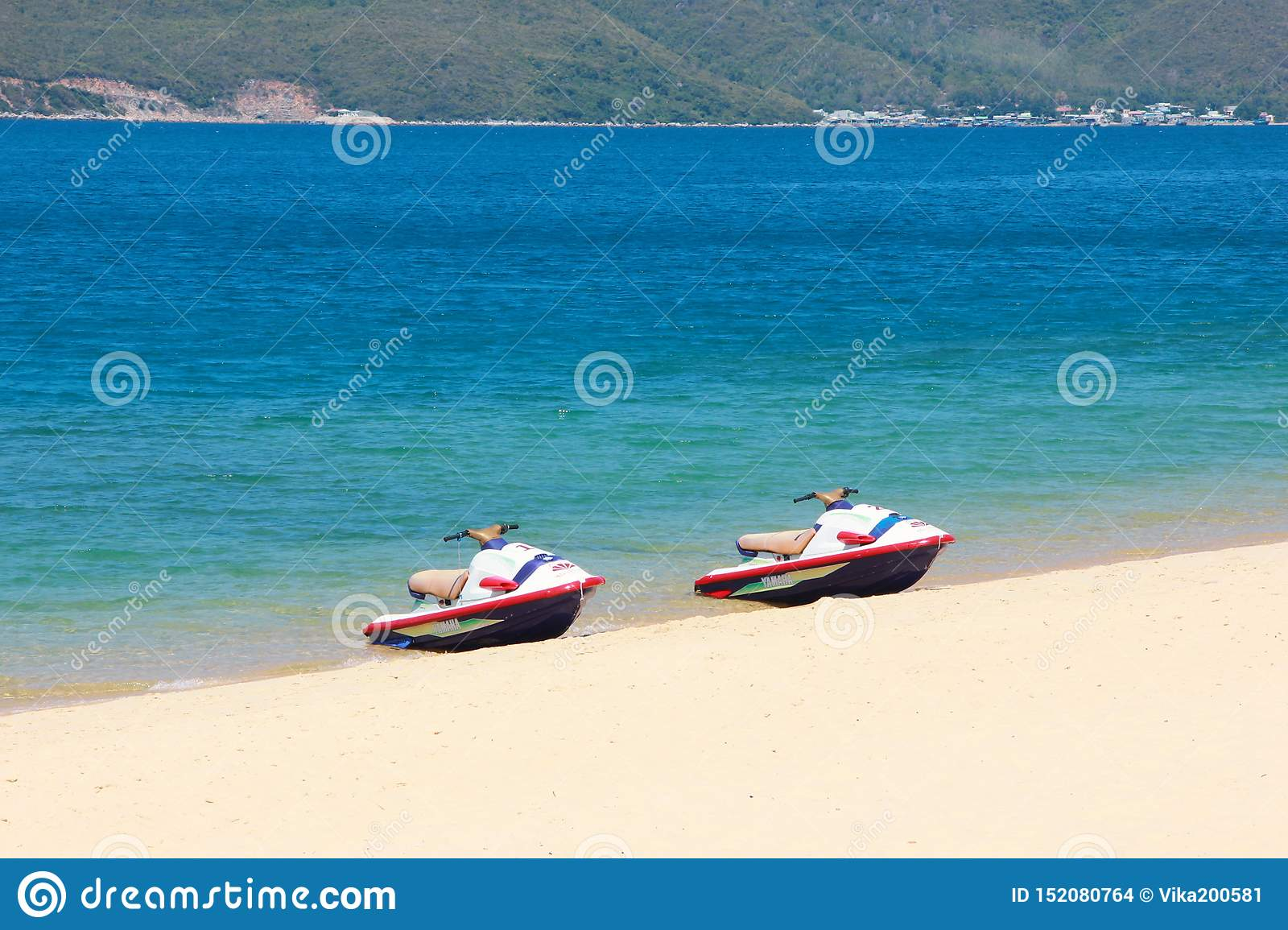 Two hydroscooters are on the beautiful beach