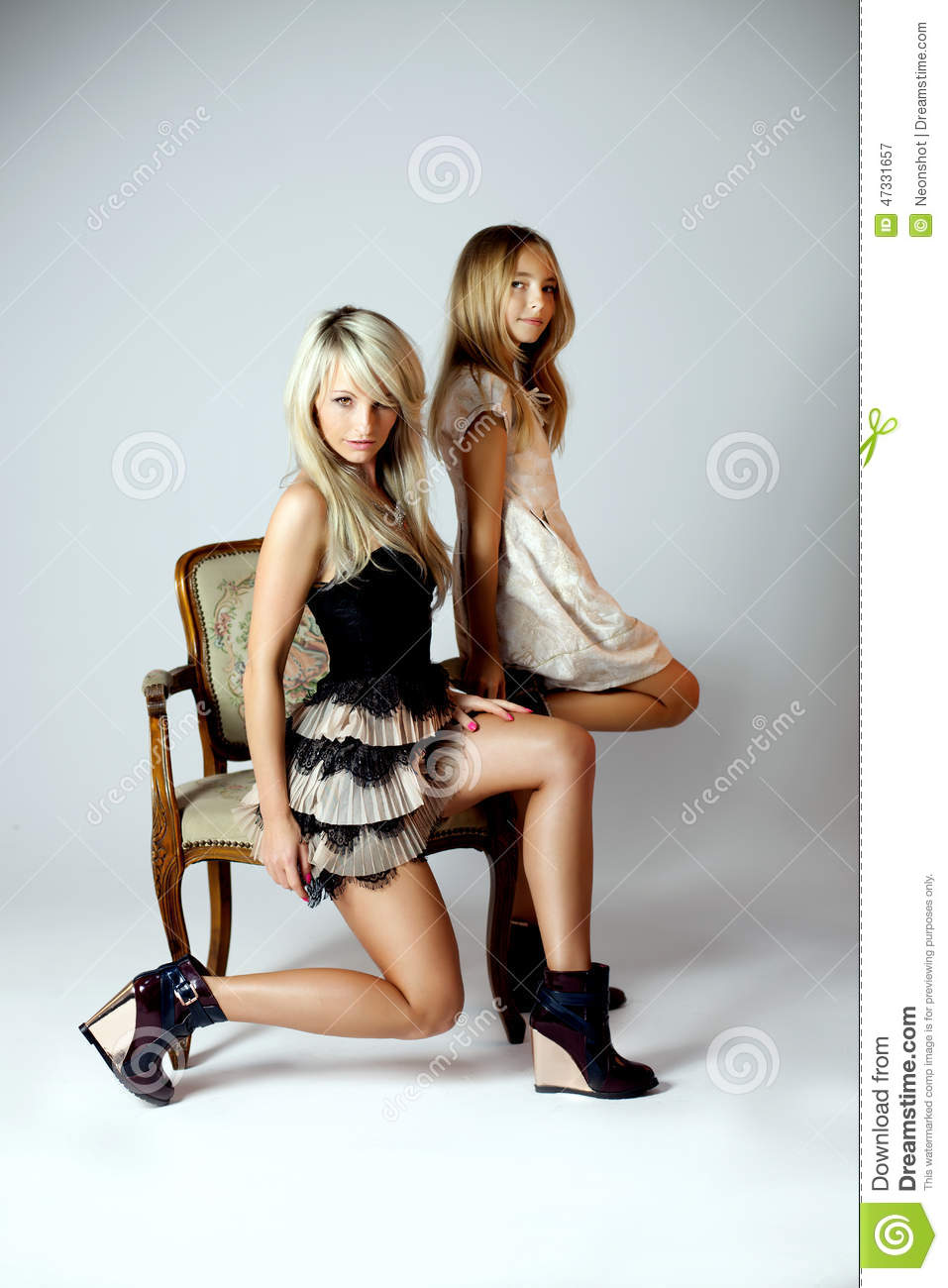 Beautiful Mother With Daughter In Studio Stock Photo