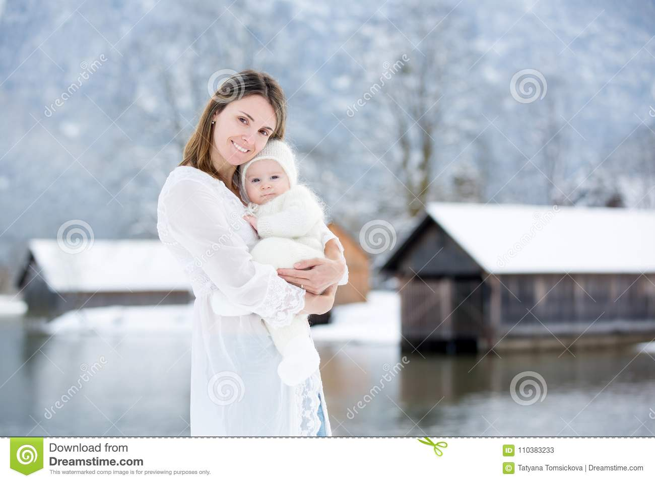7c1319df4 Beautiful Mother In White Dress And Cute Baby Boy In Knitted One ...