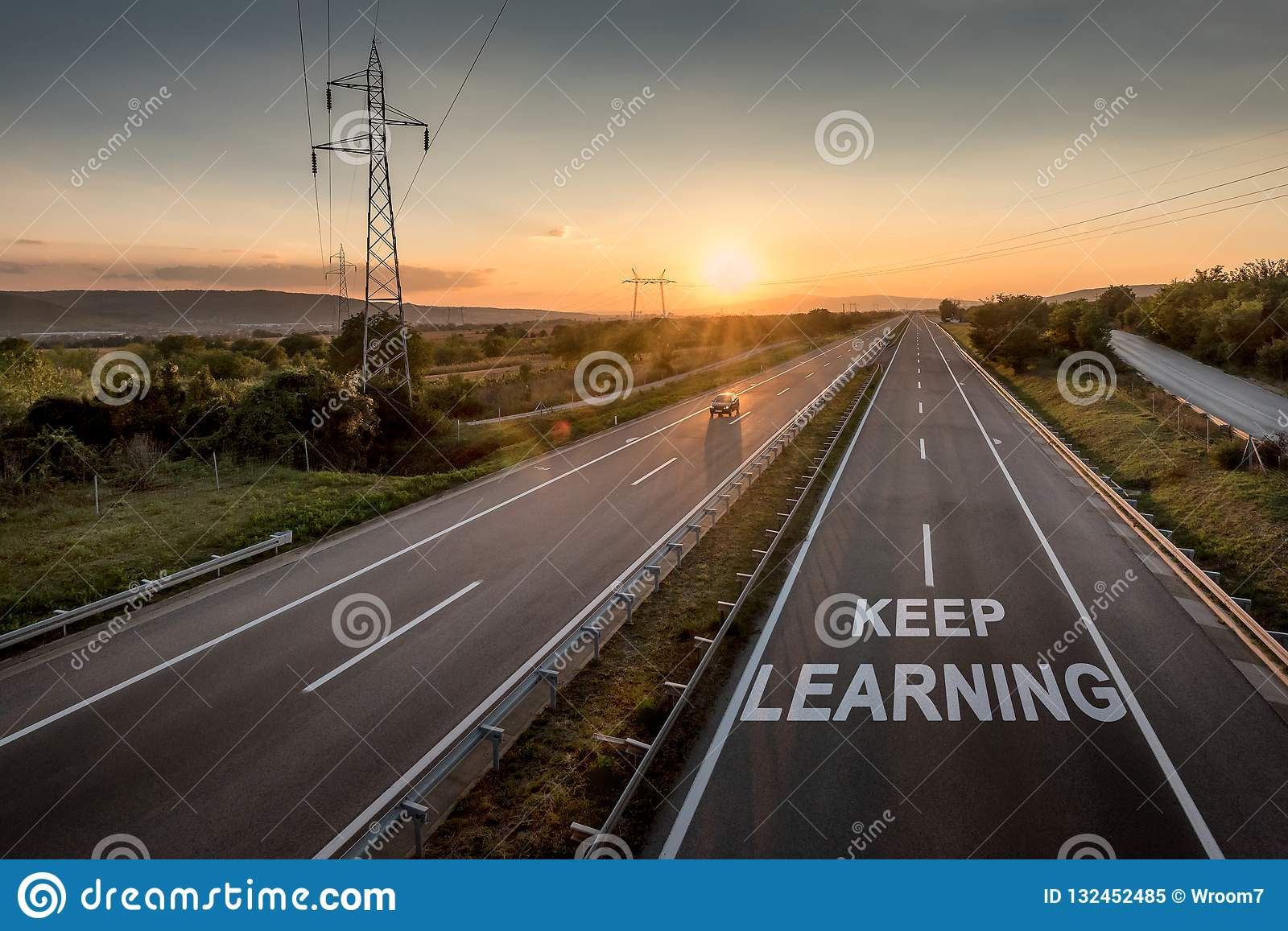 Beautiful Motorway with a Single Car at sunset with motivational message Keep Learning