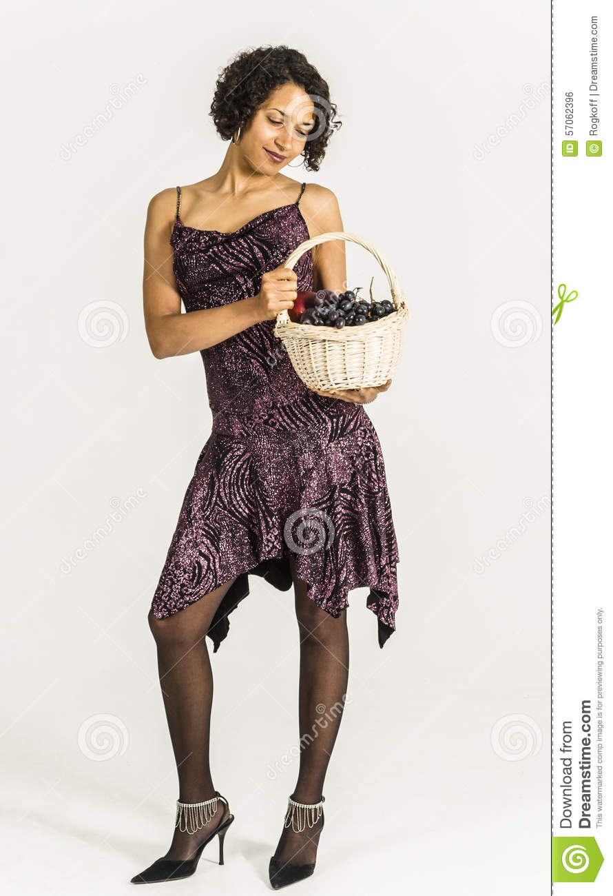 Beautiful Mulatto Woman In A Cocktail Dress With A Basket Of Fruit ...