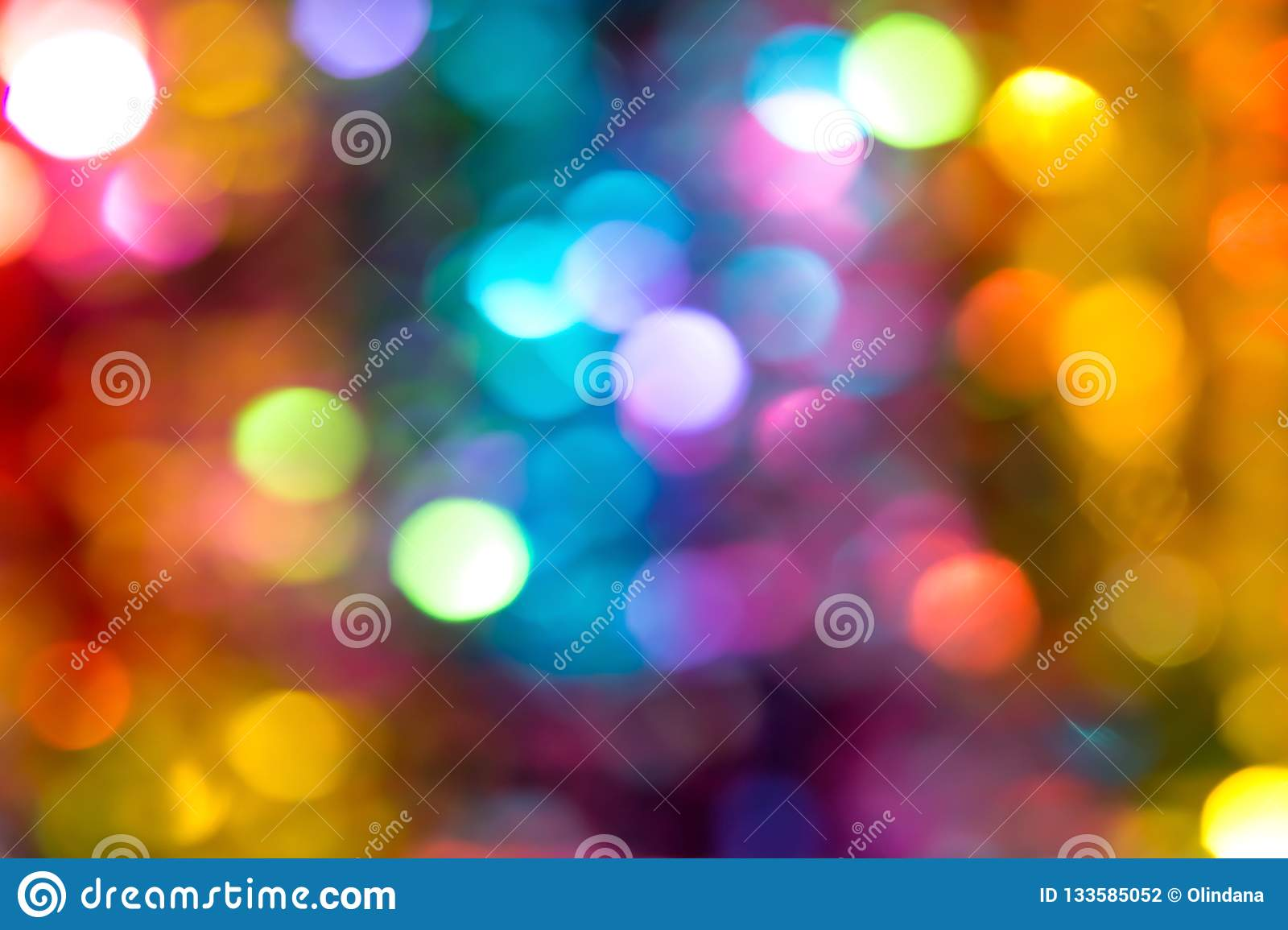 Beautiful multicolored bokeh lights holiday glitter background for Christmas New Year Birthday celebration