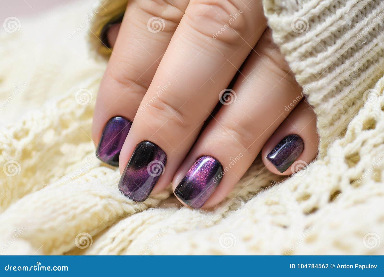 Beautiful Nail Polish In Hand Purple Nail Art Manicure White