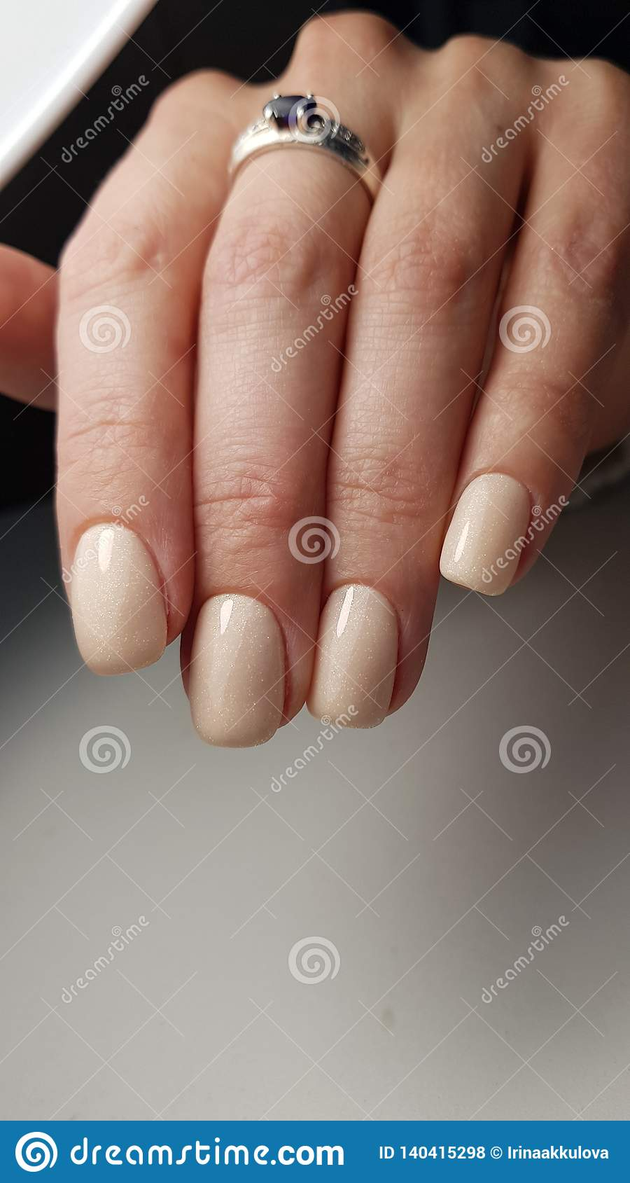 Gel Polish Nude Color With Shimmer Stock Photo Image Of Hands