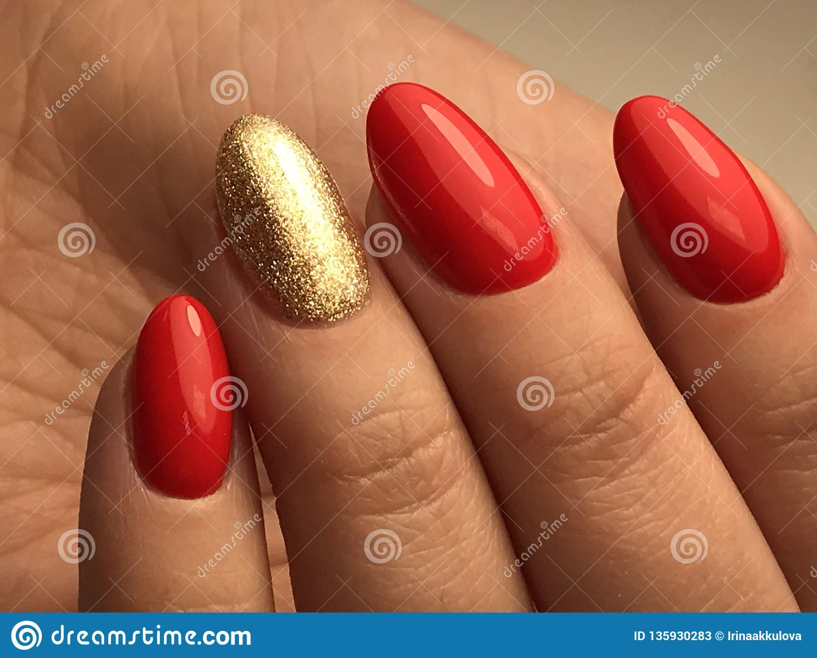 Beautiful Nails With Red And Gold Gel Polish Macro Stock Image