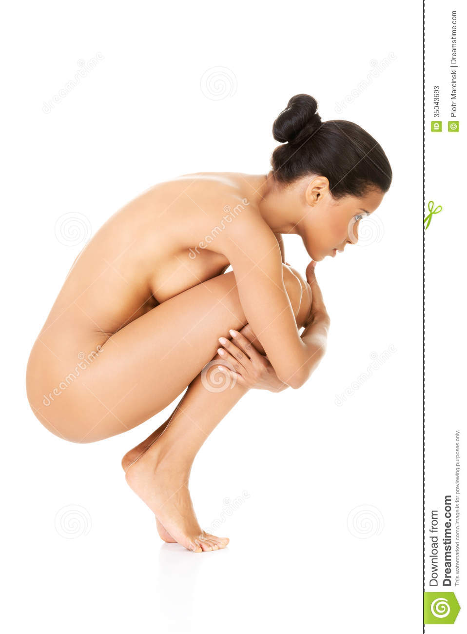 Young crouching nude girl
