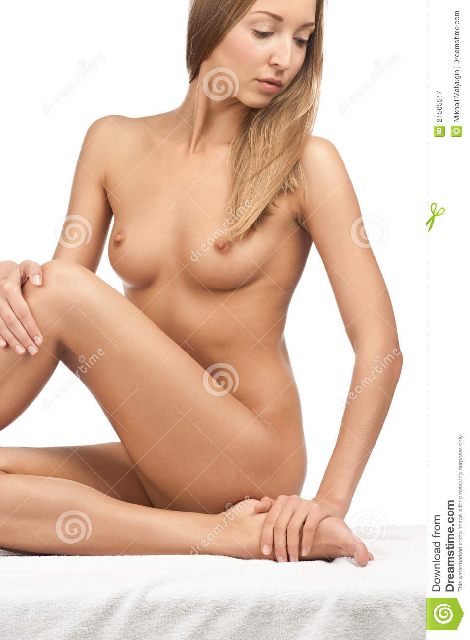 Naked Woman With Slim Body Sitting On White Sheet Isolated