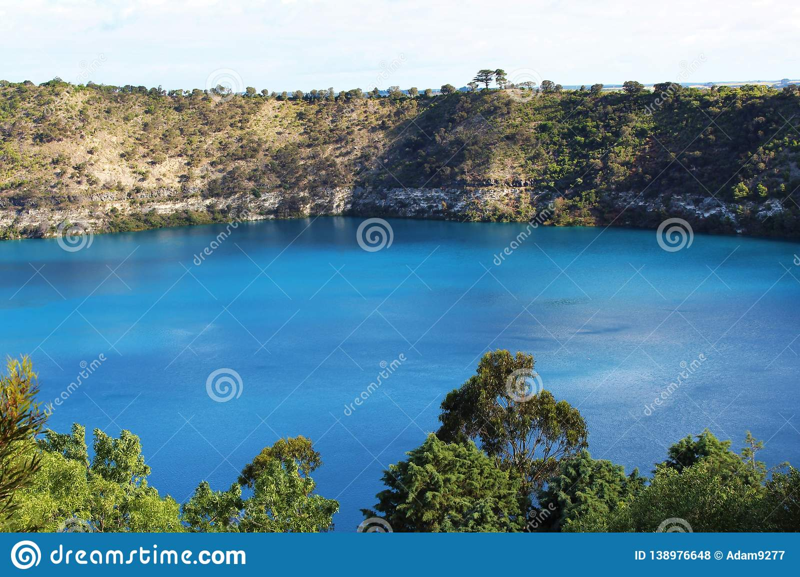 Stunning blue lake at Mount Gambier, Australia. Beautiful natural blue lake at Mount Gambier, Australia. Pure blue lake surrounded by cliffs with trees and royalty free stock photos