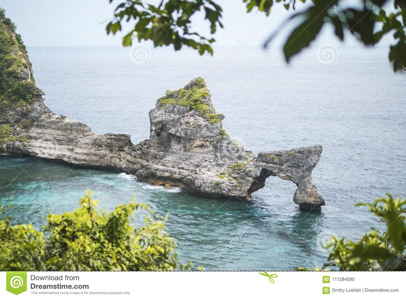 Beautiful Natural Rock Arch Island in the Sea at Atuh Beach in Nusa Penida, Bali, Indonesia. Aerial View.