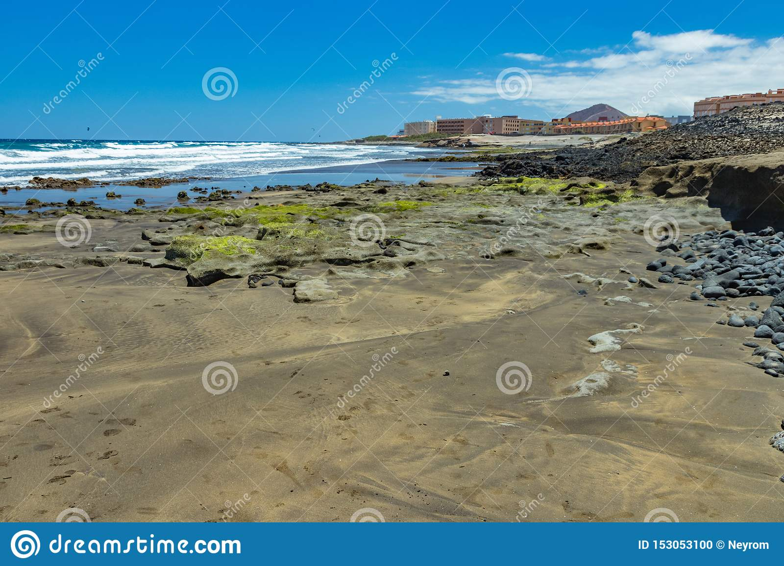 Beautiful natural southern coastline with wildlife, rocks and beaches near El Medano. Sunny day, blue sky and white fluffy clouds