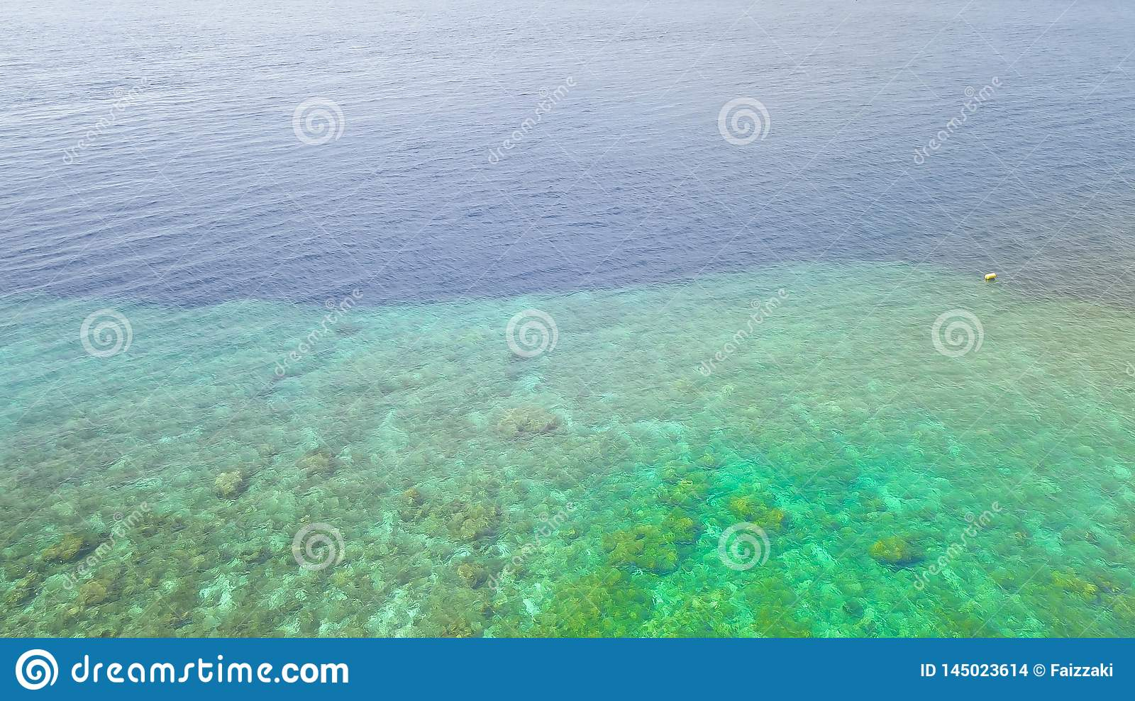 Beautiful nature of blue sea sand and Turquoise color water waves