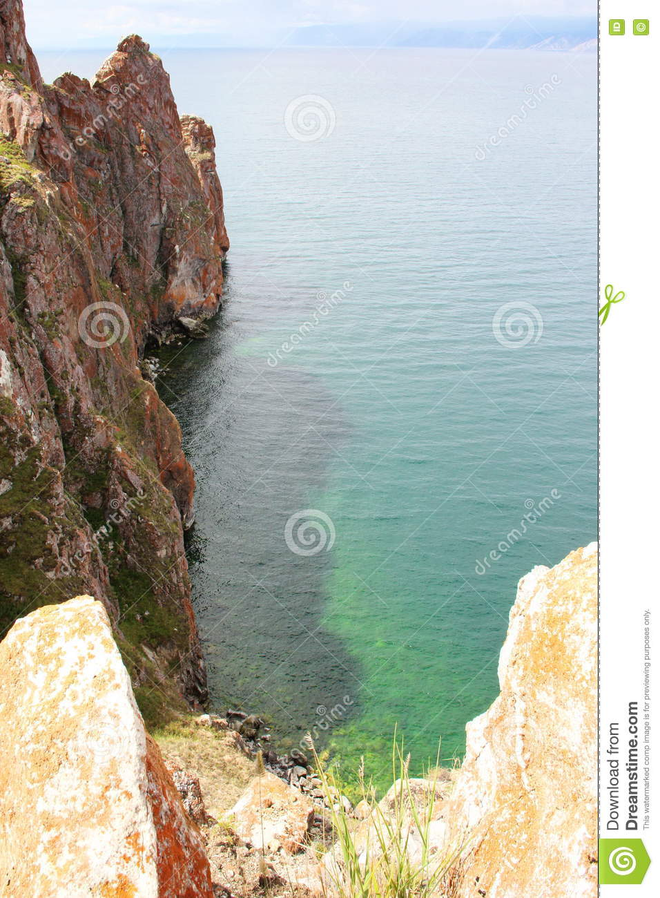 Beautiful nature of lake in the summer, high mountains and clear green, purple water of Lake Baikal, Siberia, Russia - landscape