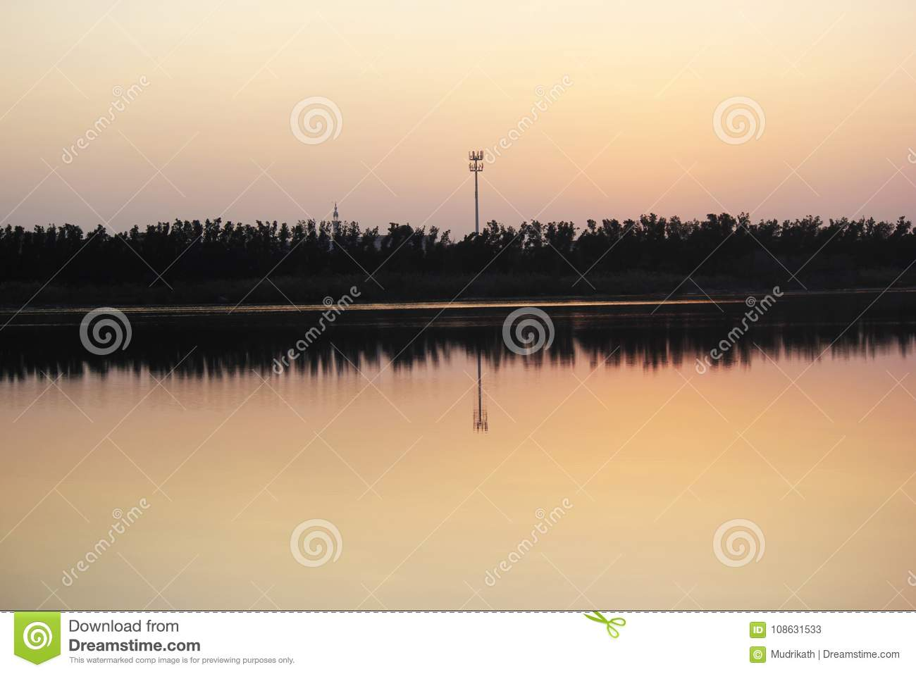 Beautiful nature scenery of water, trees and sky shadows in the water.