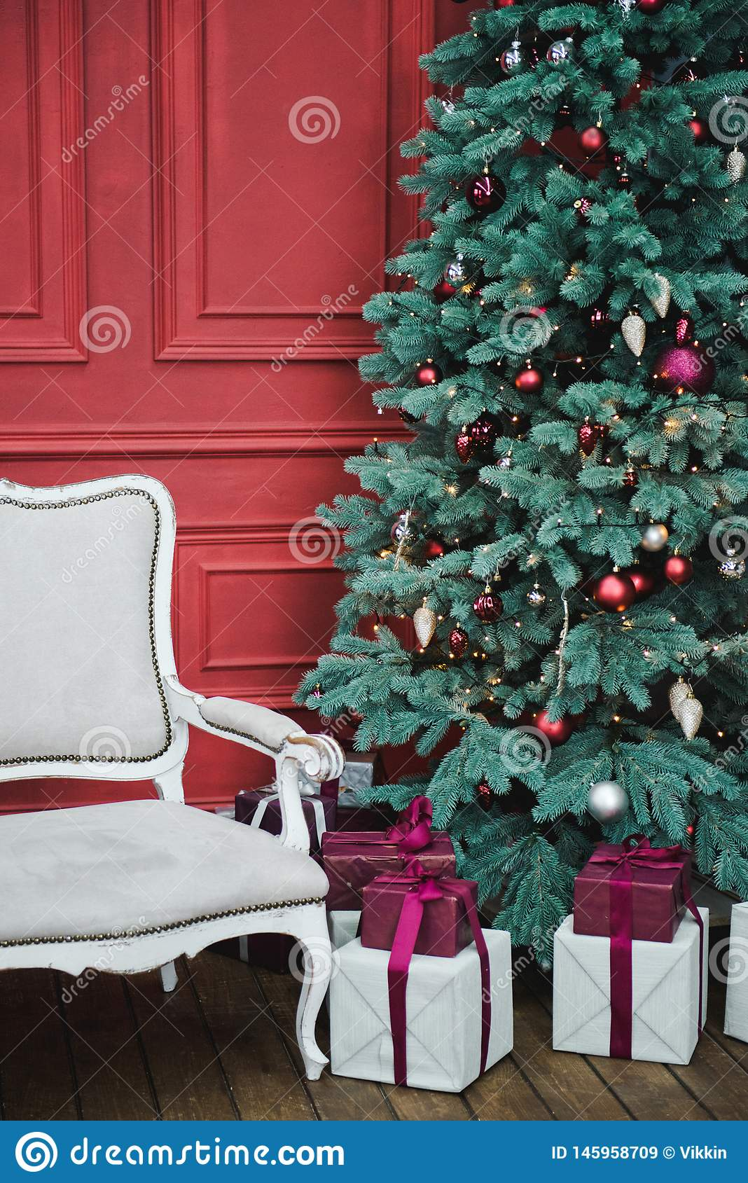 Beautiful New Year decorated classic home interior. Winter background. Living room with a Christmas decor. Holiday background. New