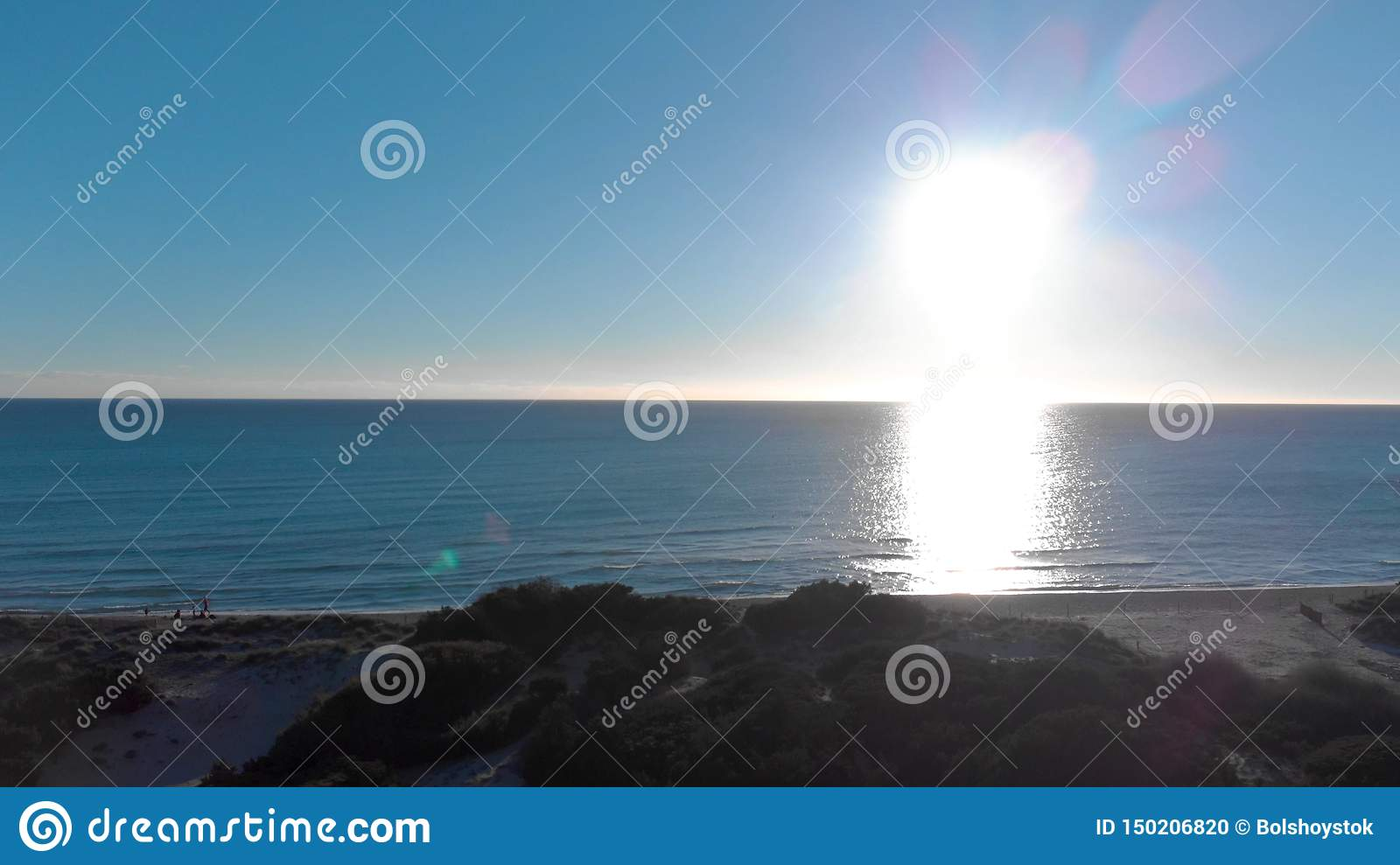 Beautiful New Zealand nature, sea, green fields, meadows, hills and people on the shore. Art. Bright sunset over the