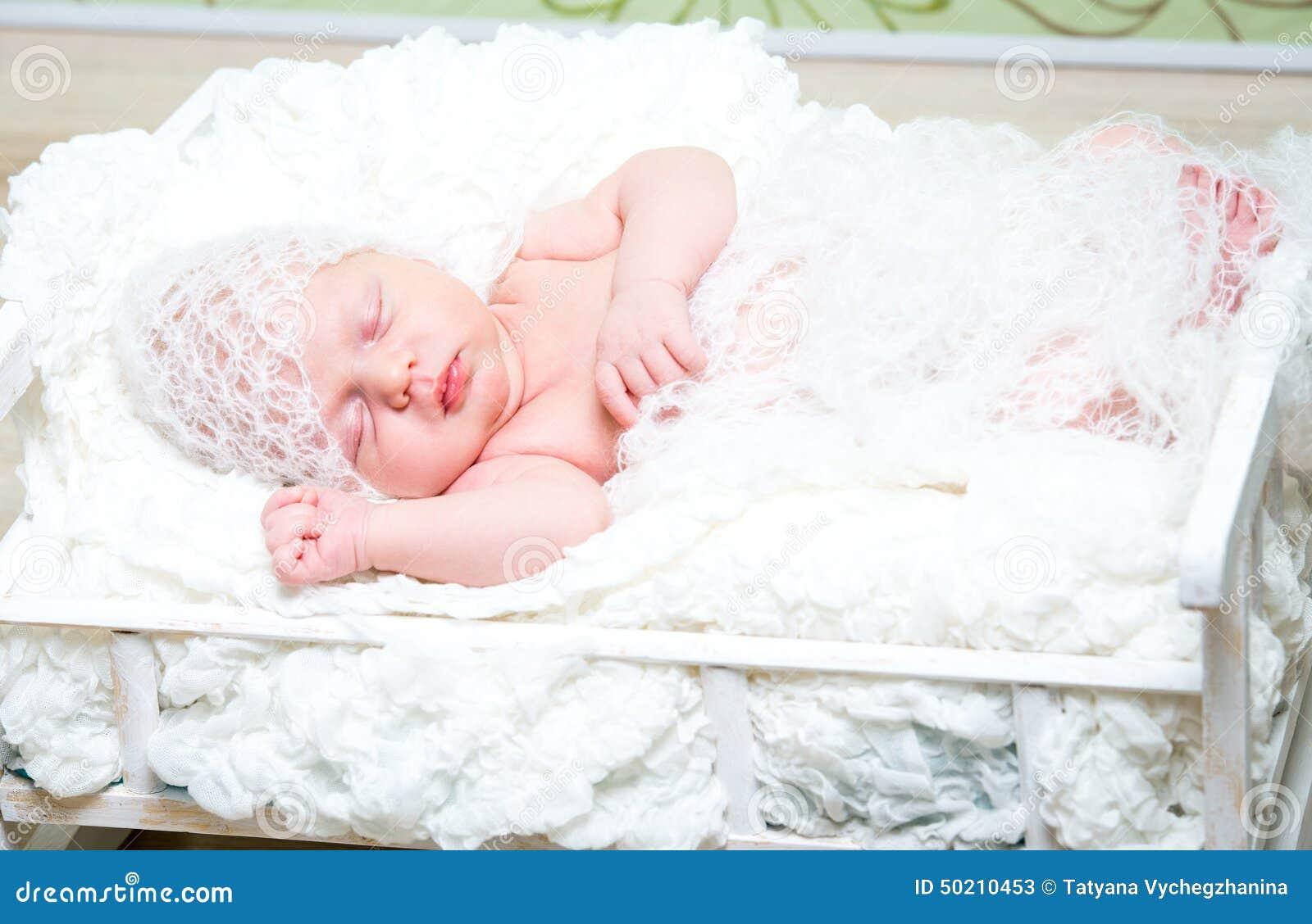 Beautiful Newborn Baby Boy Sleeping In Knitted Cap Stock Image ... 1f9d3397662