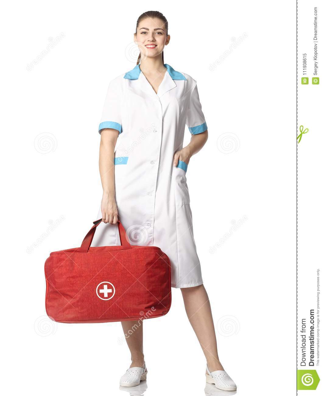 Beautiful nurse girl in suit with red bag and white cross.