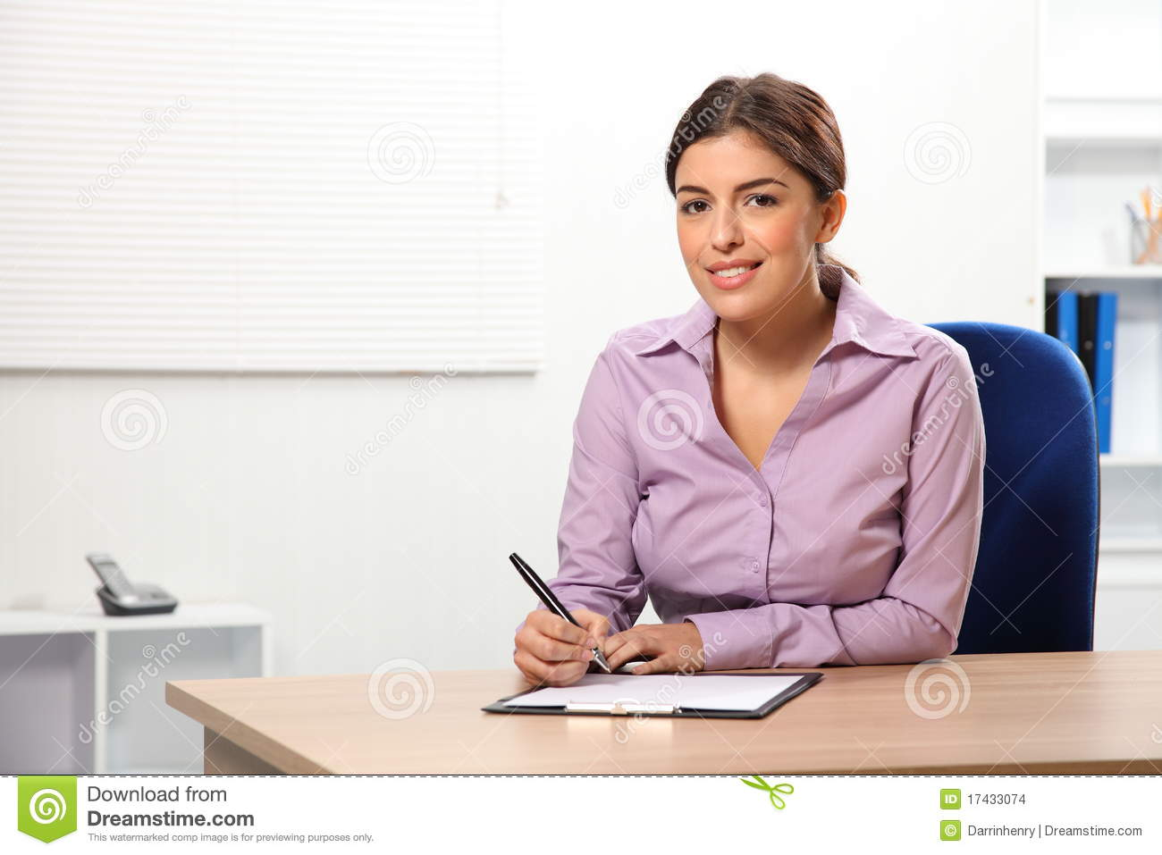 Beautiful office woman sitting to desk writing stock photo for Beautiful office pictures
