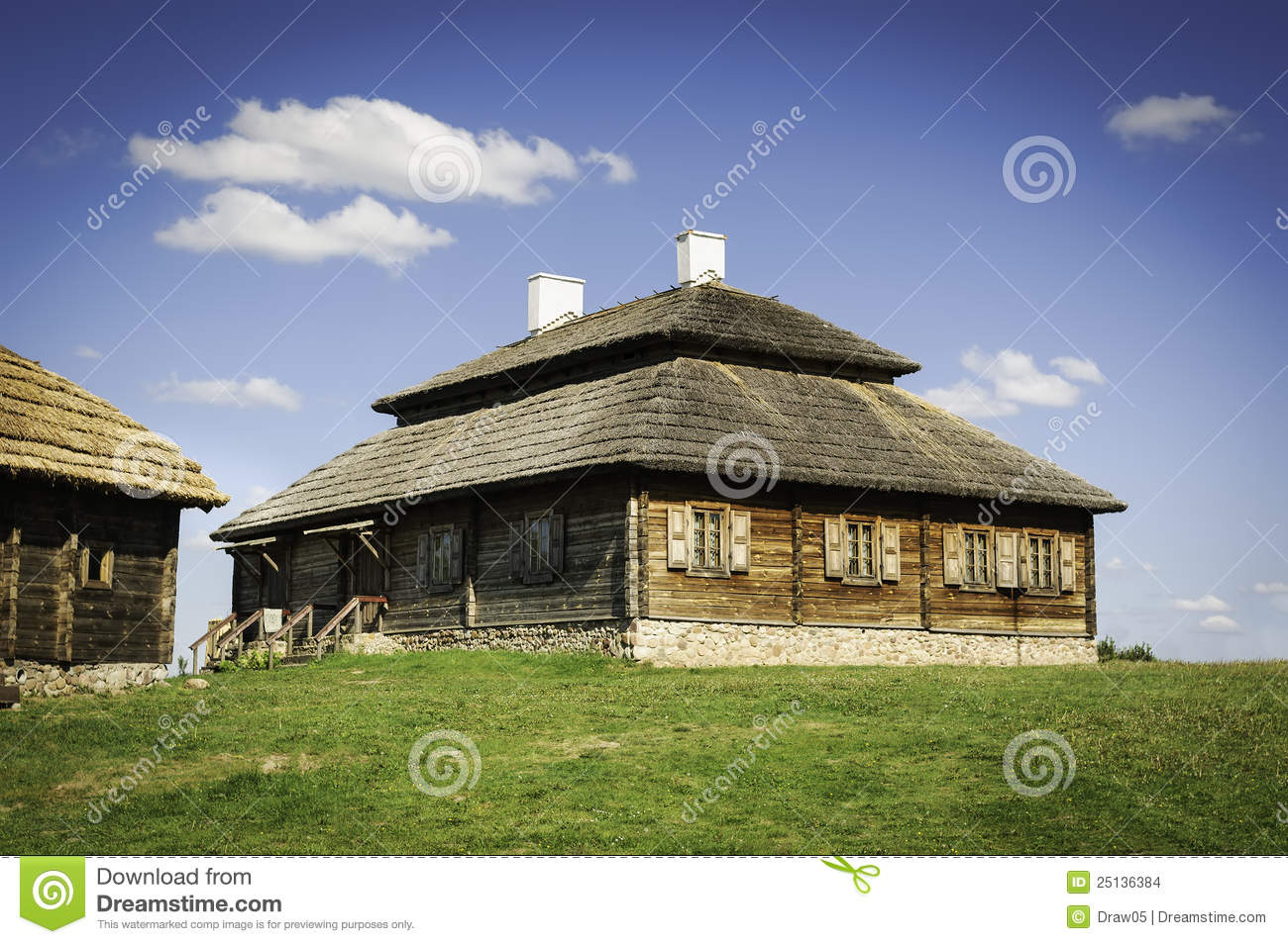 Beautiful Old Style Farmhouse With Thatch Roof Stock Photo