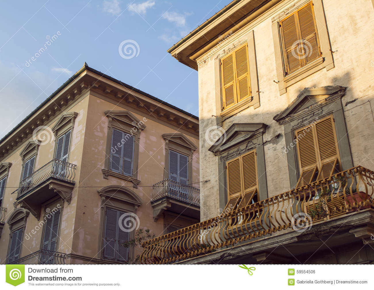 Beautiful, old sunlit house facades in Levanto, Italy.