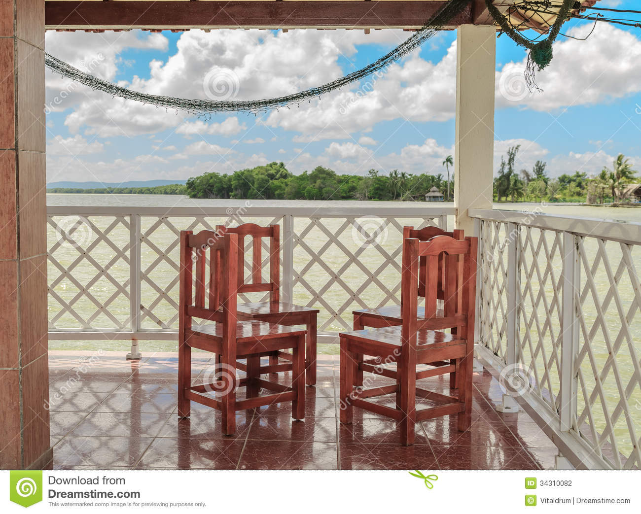 Wooden chairs on ceramic tiles floor royalty free stock for Terraces opening times