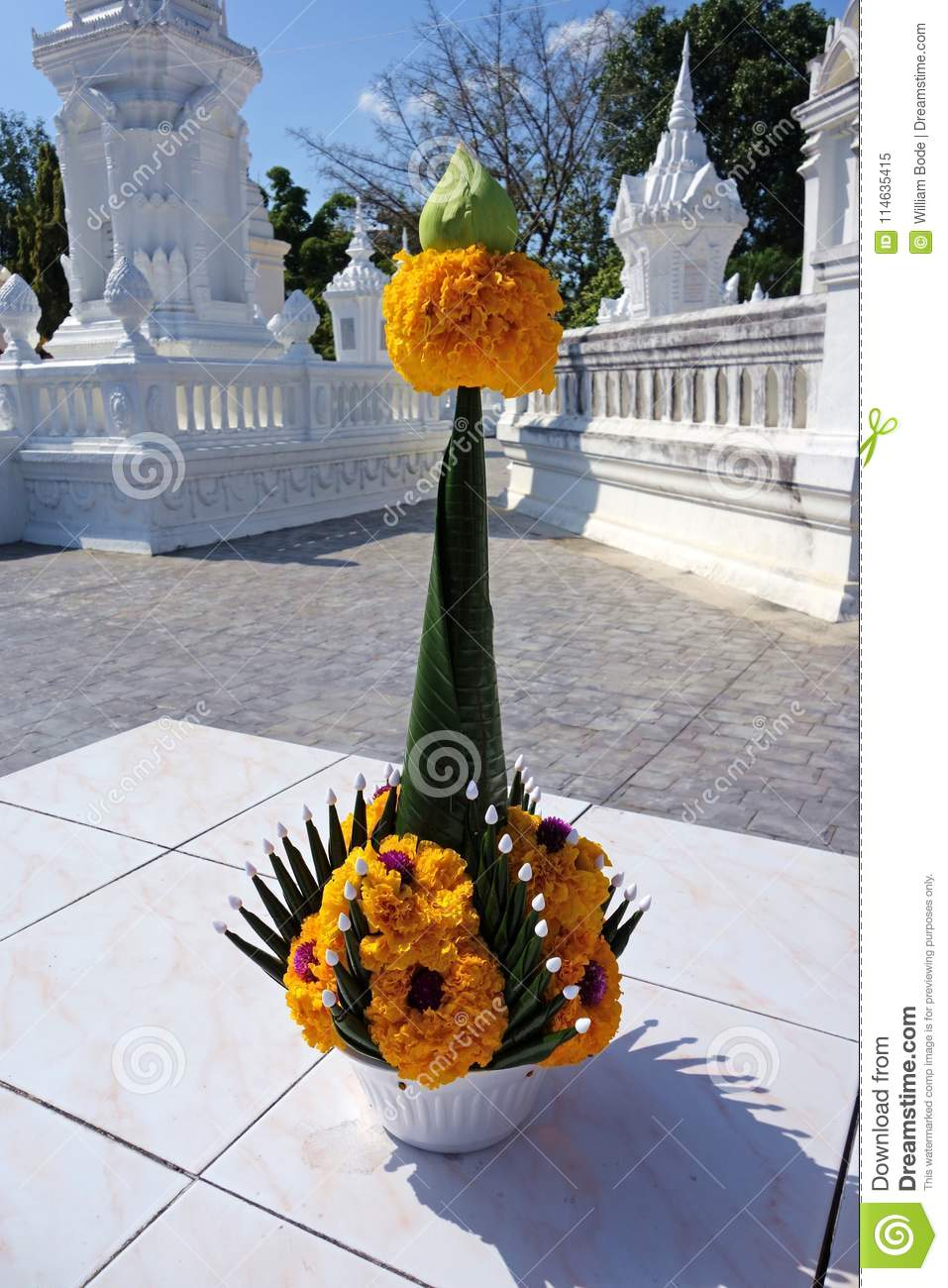 Thai flower offering in white temple complex stock image image of a beautiful origami folding of banana leaves to create a nice bouquet with orange marigold flowers and a lotus bud izmirmasajfo