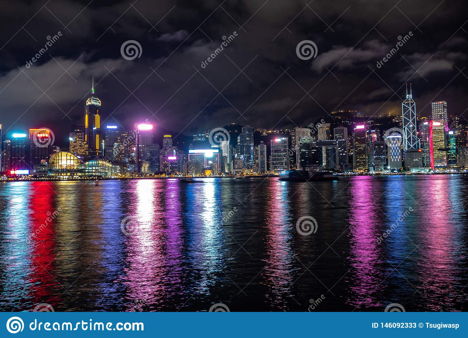 Beautiful panorama scene of hong kong city midtown at night with skyscrapers illuminated reflecting in the river